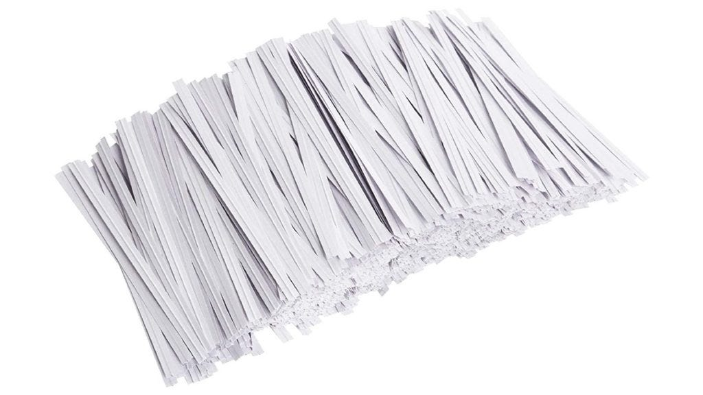 a large stack of white twist ties