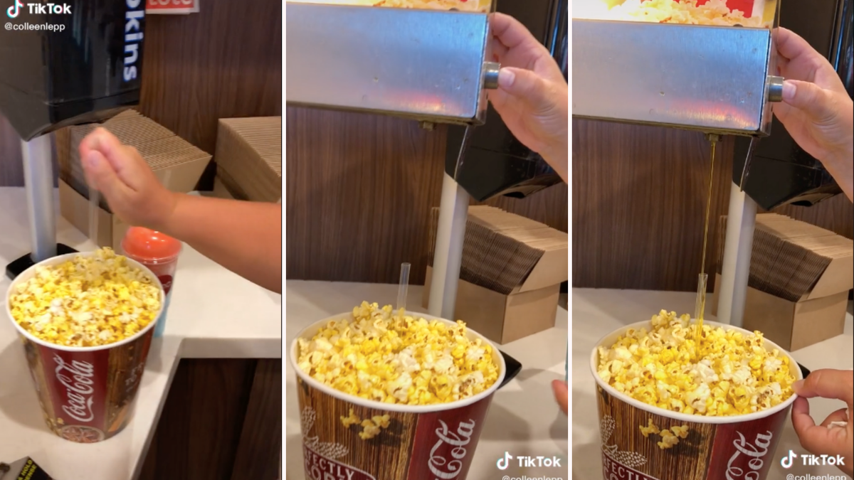 A woman inserts a plastic straw into a bucket of popcorn and drains butter through it from the dispenser.