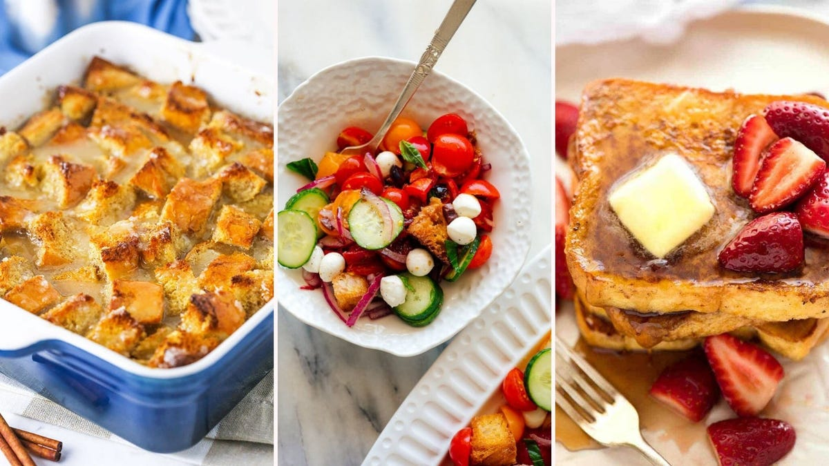 A casserole dish full of bread pudding, a plate of Panzanella salad, and a plate of French Toast topped with butter, strawberries, and syrup.