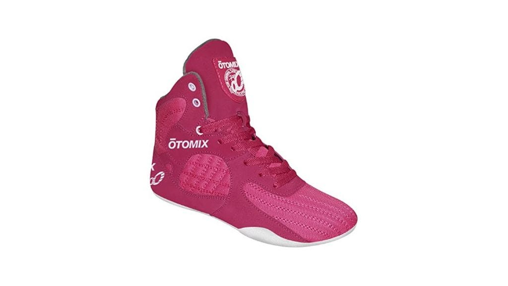 a pink weightlifting shoe with a high tongue and laces