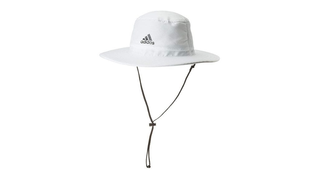 a white Adidas sun hat with a chin strap
