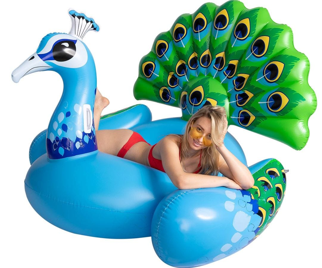 A woman lounging on the JOYIN Peacock Pool Float.