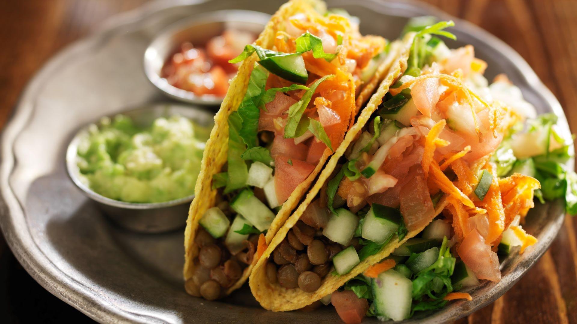 Vegetarian lentil tacos on a plate.