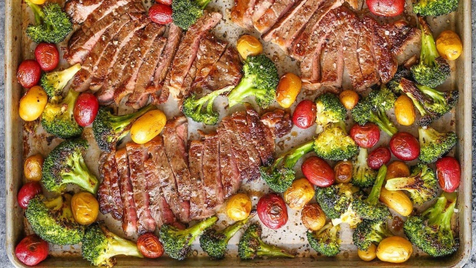 A sheet pan full of steak and veggies.