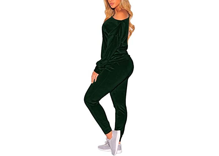 Side view of woman in matching cold shoulder long-sleeved shirt and jogger workout suit