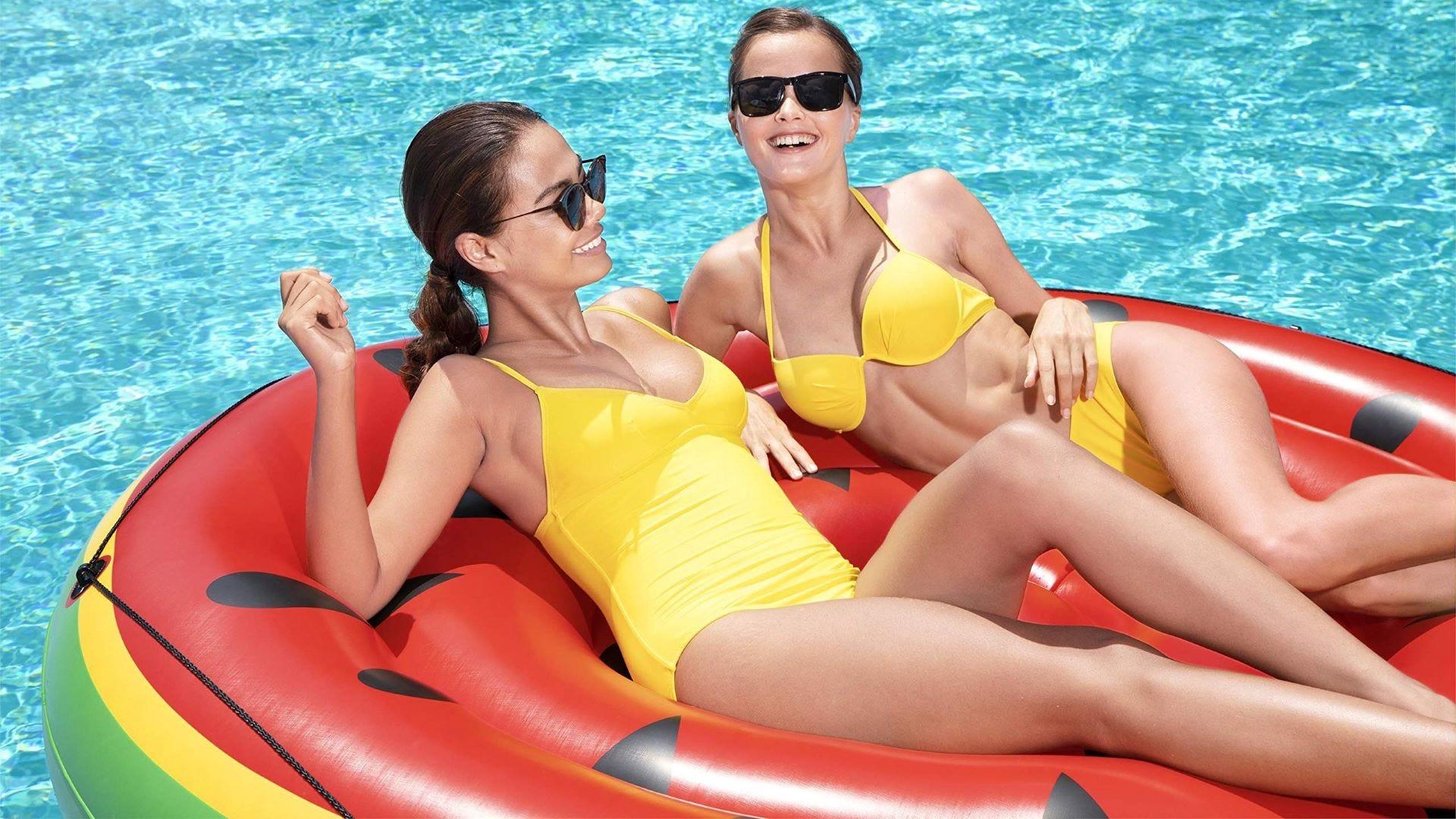 Two Women floating on the Bestway Watermelon Island.