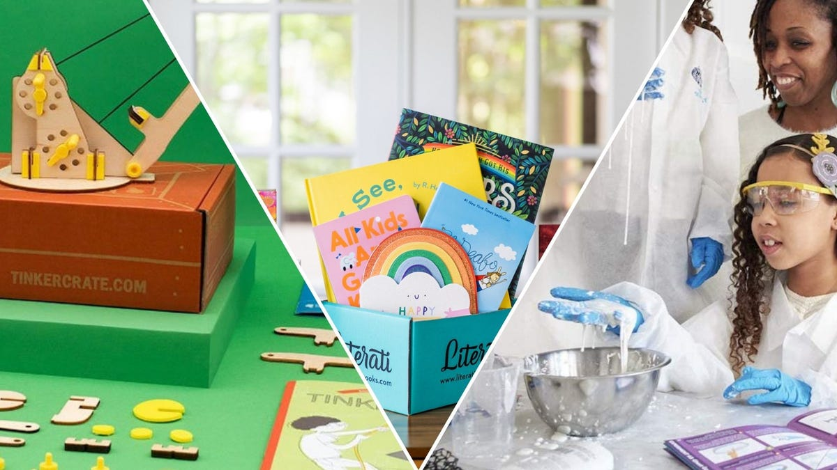 A box with a toy crane on top of it; a box of children's books; a child and parent doing a science experiment