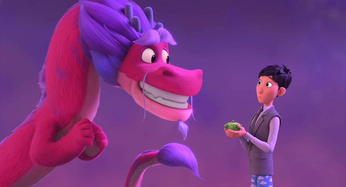 A pink and purple dragon smiles at Long in a scene from