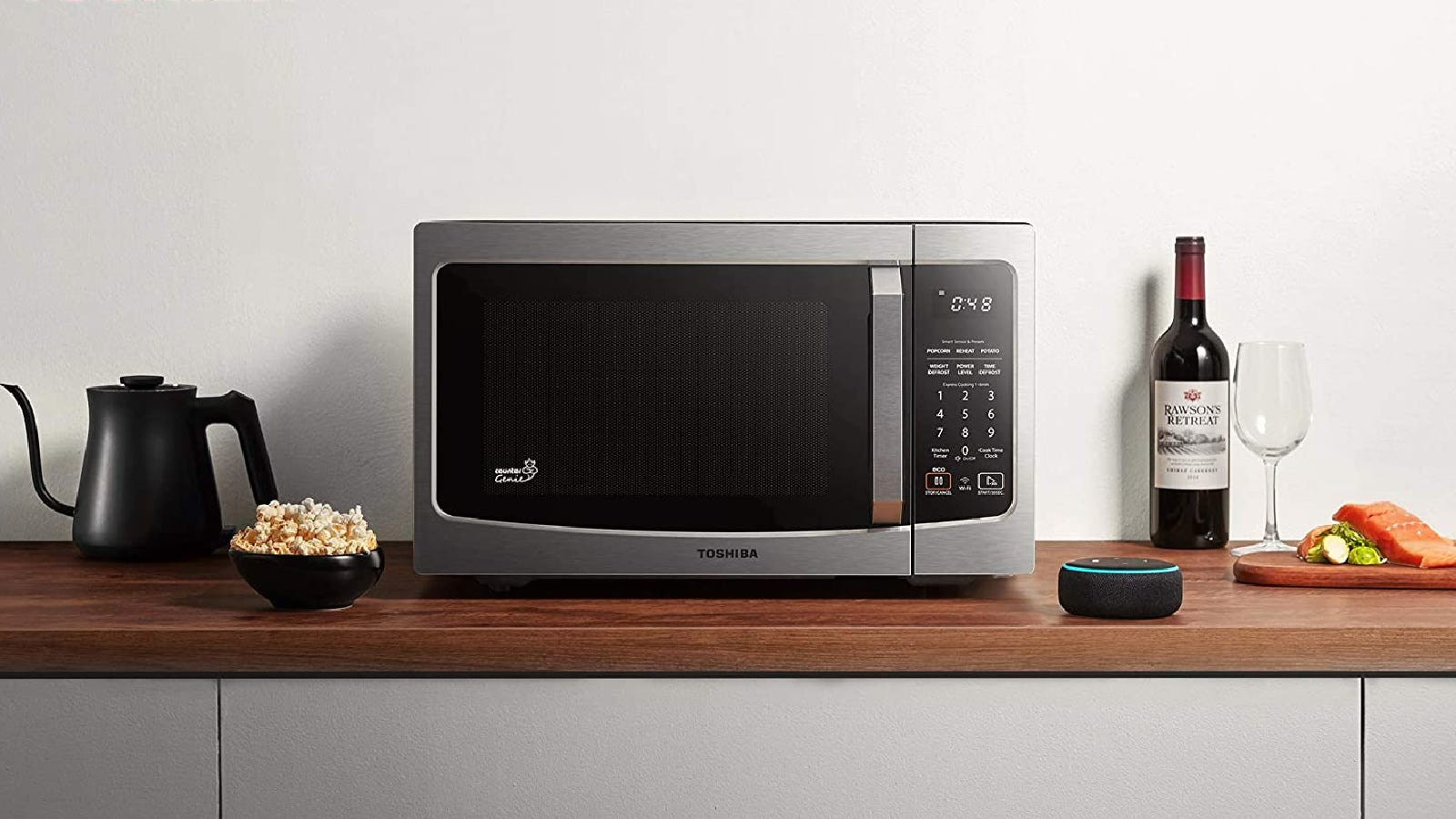 A brand new Toshiba smart microwave set up on a counter near an Alexa virtual assistant technology.