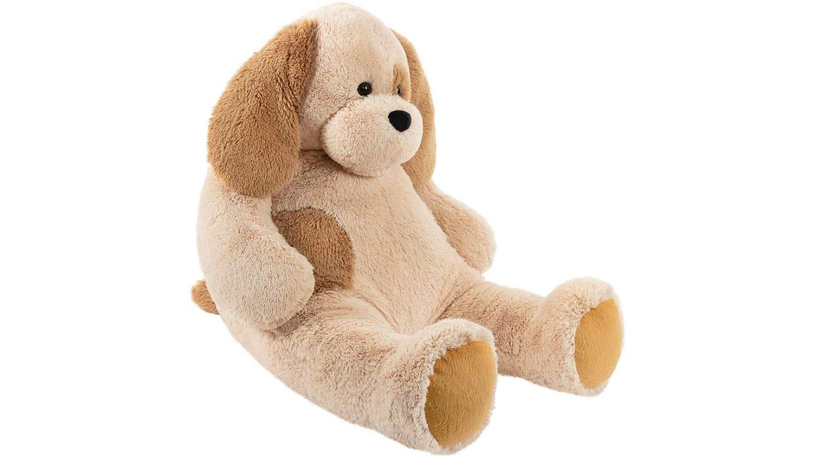 Large dog stuffed animal with brown fur.