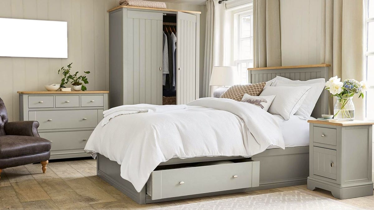 A matching sage-colored bedroom set.