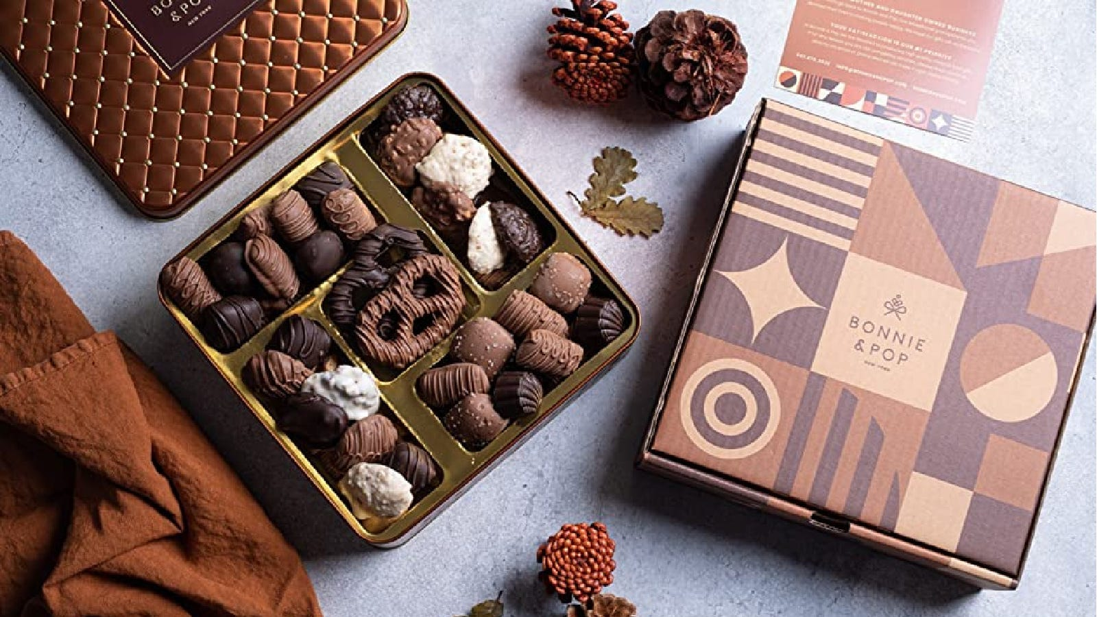 A lovely Bonnie and Pop box of assorted chocolates displayed, perfect for gifting.