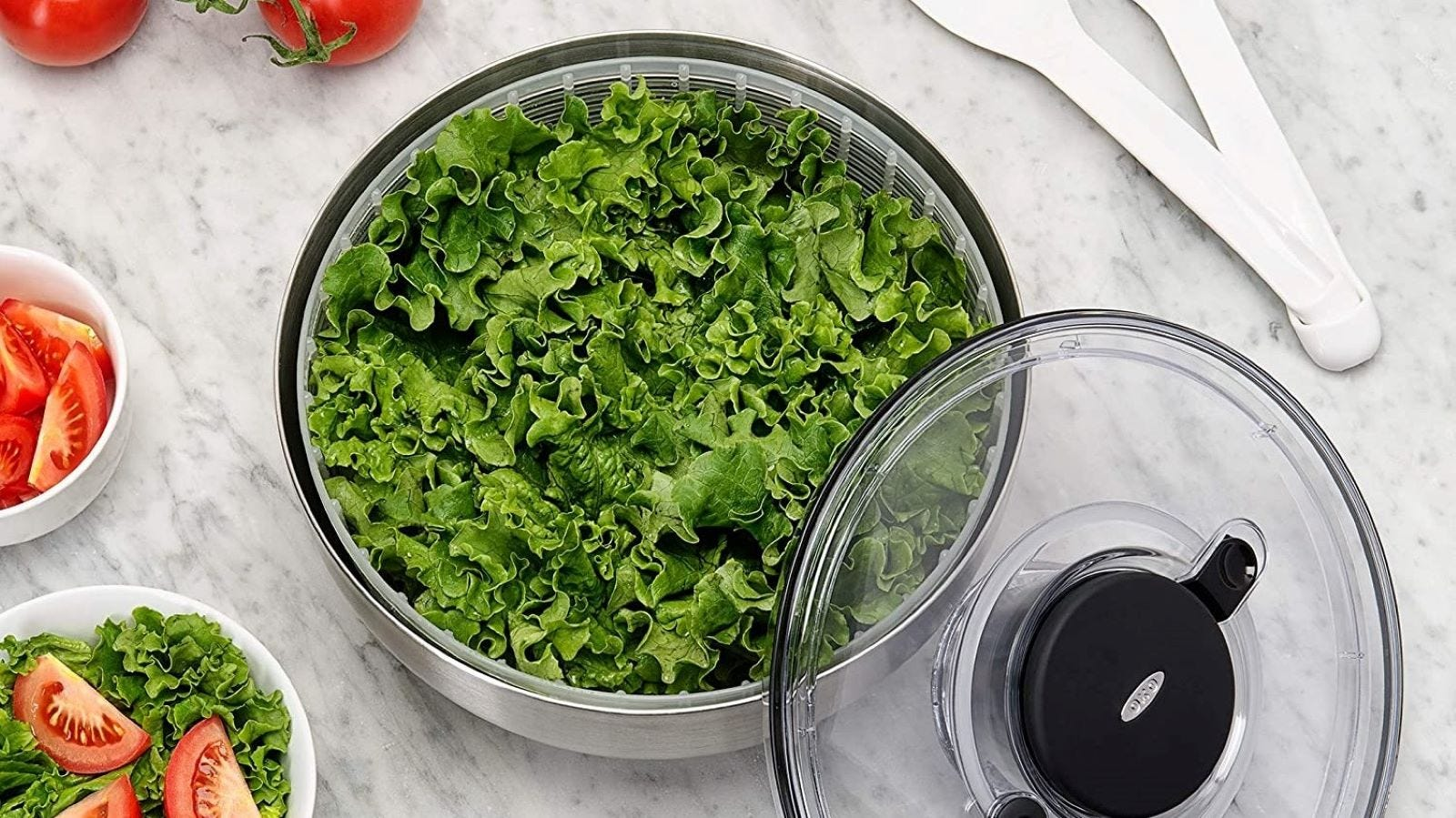 The OXO salad spinner full of leafy green letuuce.