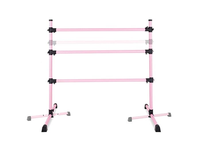 pink ballet barre with black adjustable locks and feet