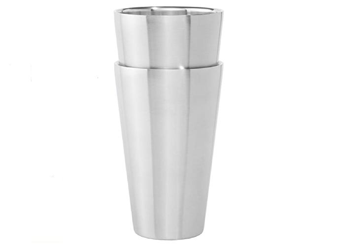 two stacked stainless steel beer glasses