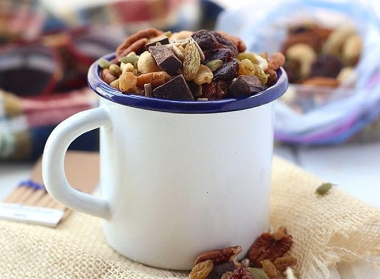 A mug full of homemade trail mix.