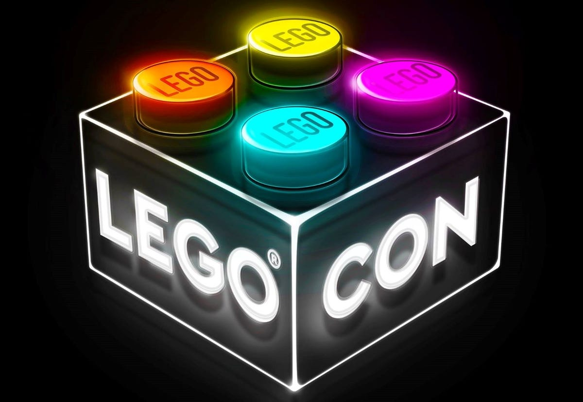 """A black LEGO brick with """"LEGO CON"""" on two sides."""