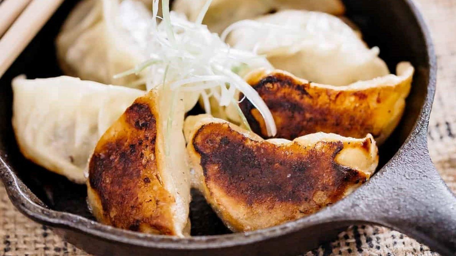 A frying pan full of Gyoza.
