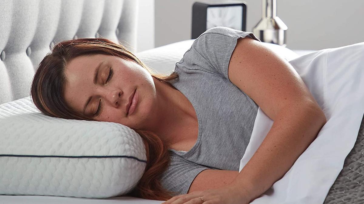 woman sleeping in bed on a memory foam pillow