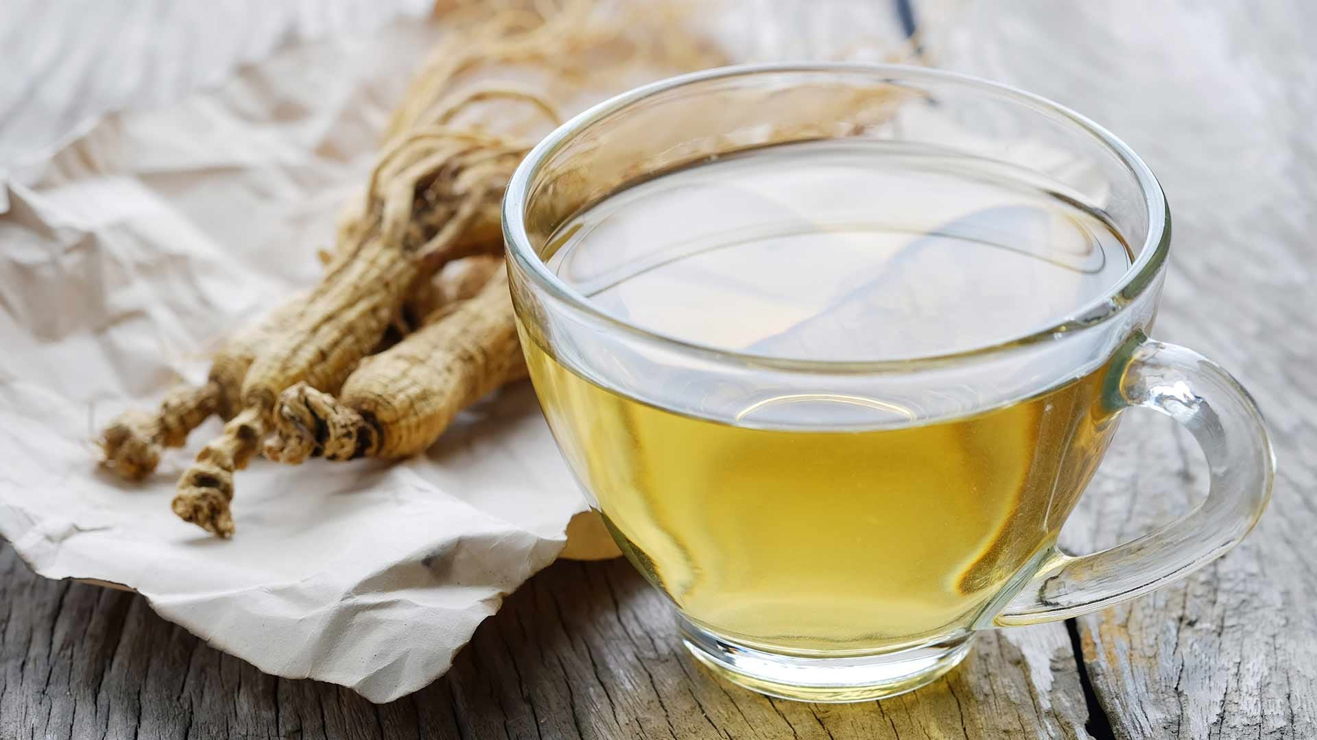 Fresh ginseng tear in a clear glass teacup.