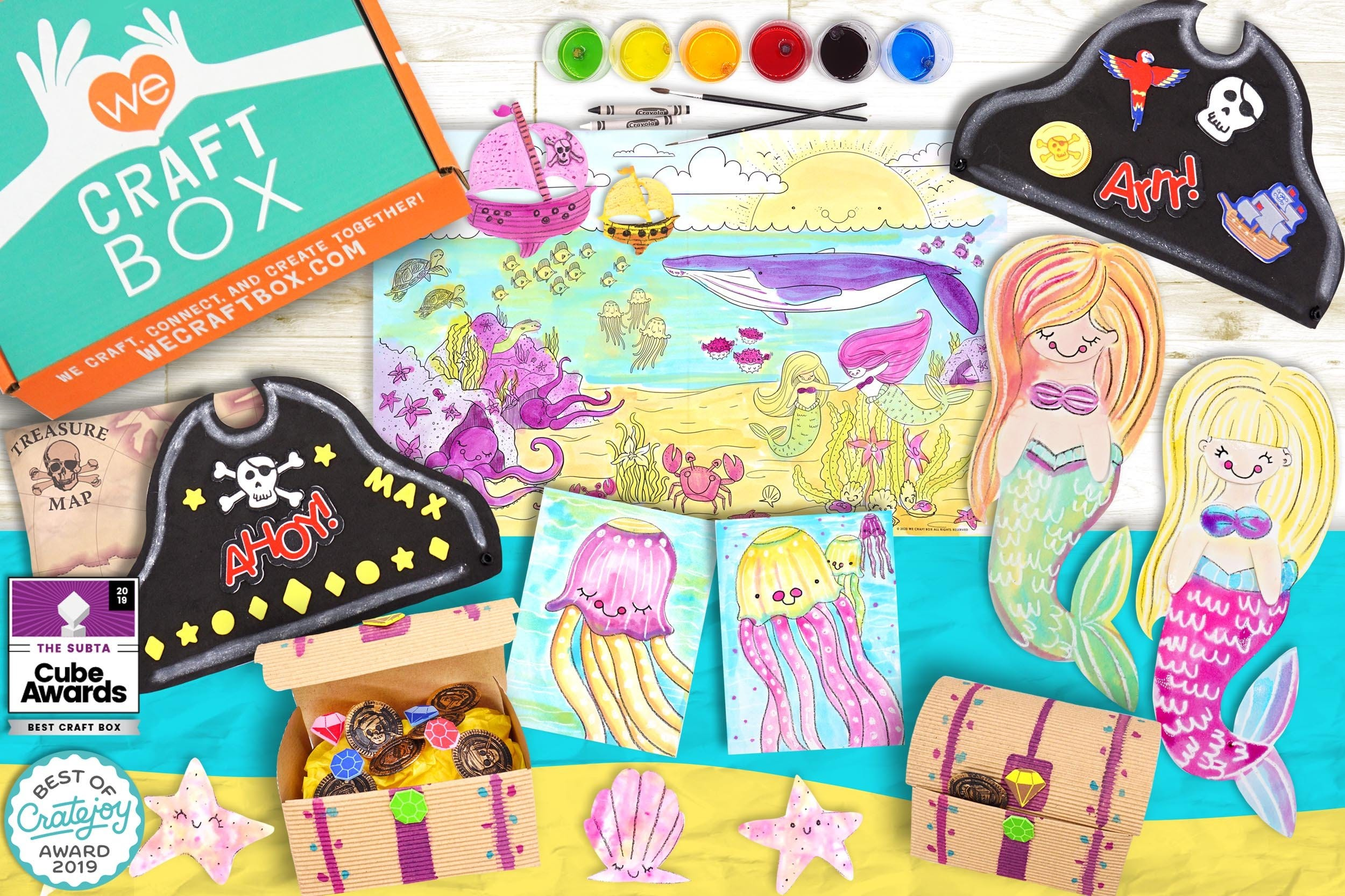 A flatlay of a mermaid-and-pirate themed craft set