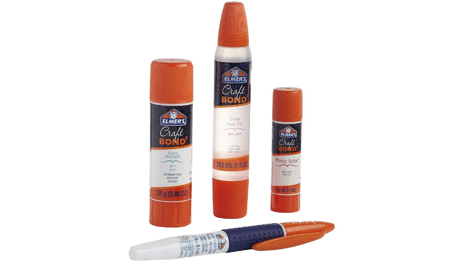 Four scrapbooking glue sticks with orange, black, and transparent packaging.