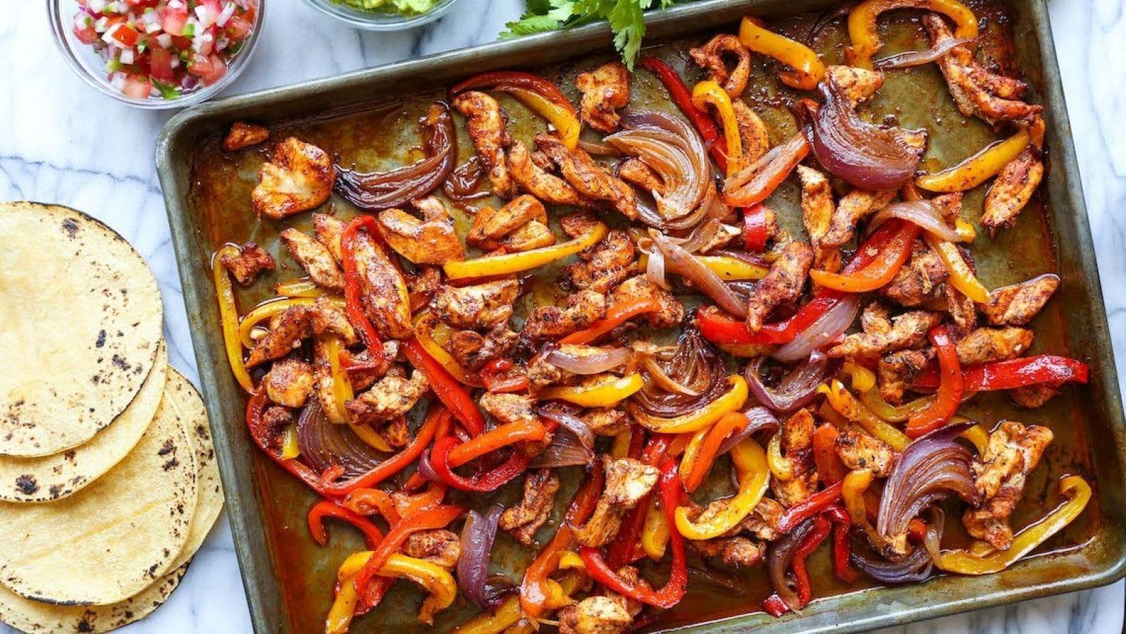 A Sheet Pan full of chicken fajitas.