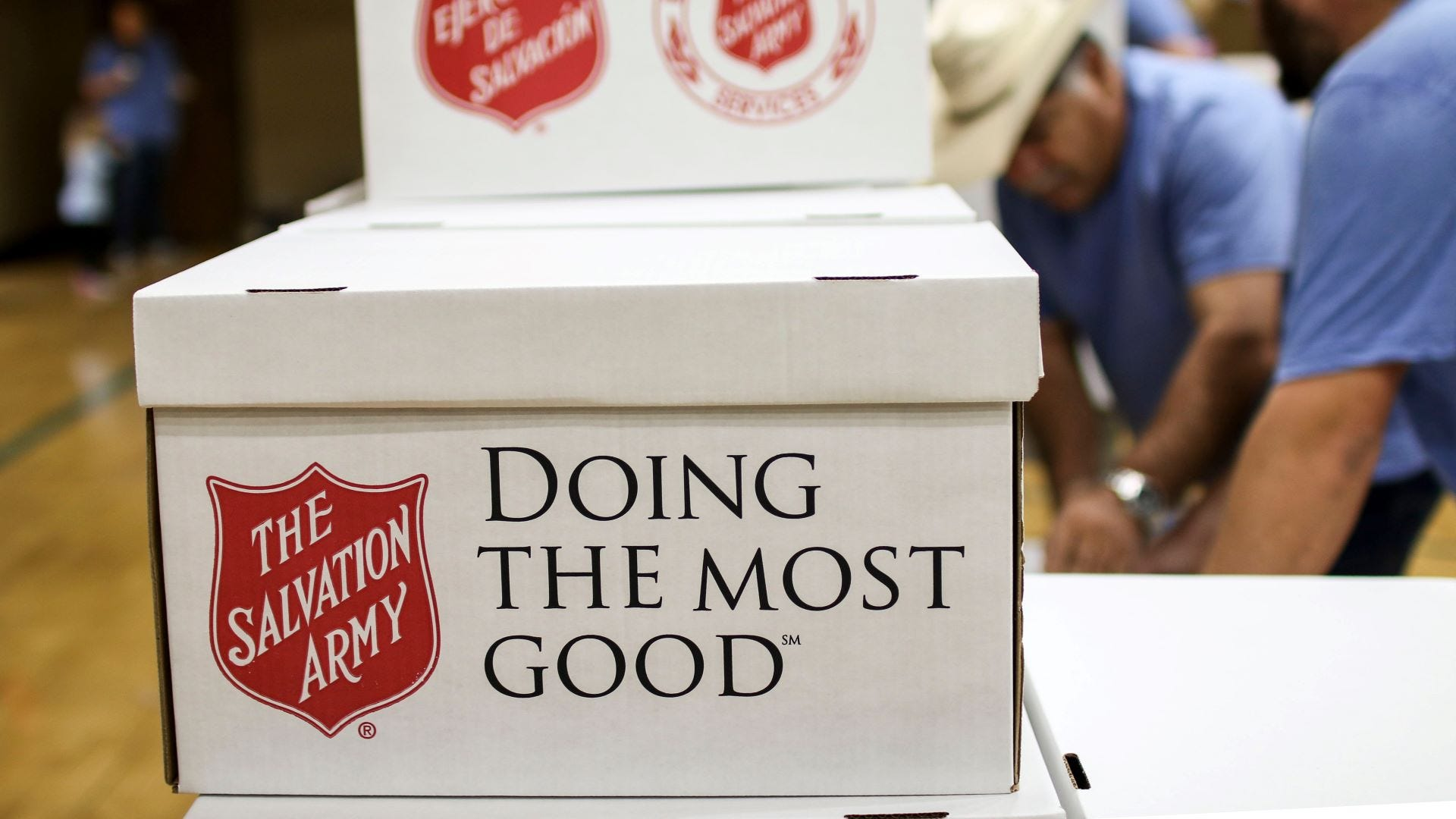 A Salvation Army donation box on a table.