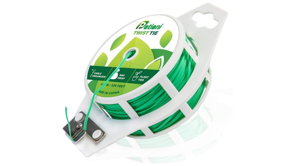 a spool of green twist tie material that can be cut to size on the end of the spool