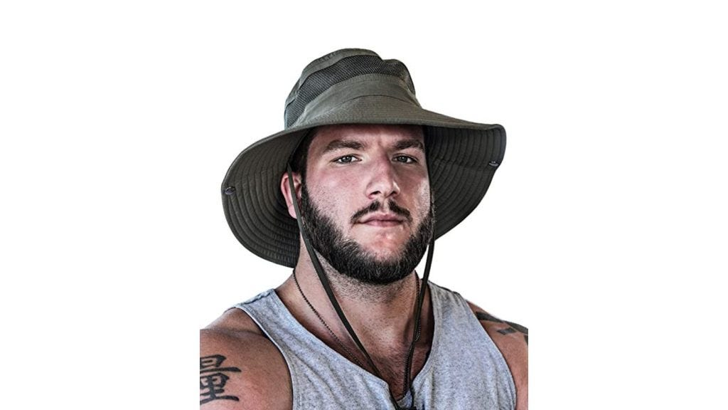 a bearded man wearing a tank top and fabric sun hat with a chin strap