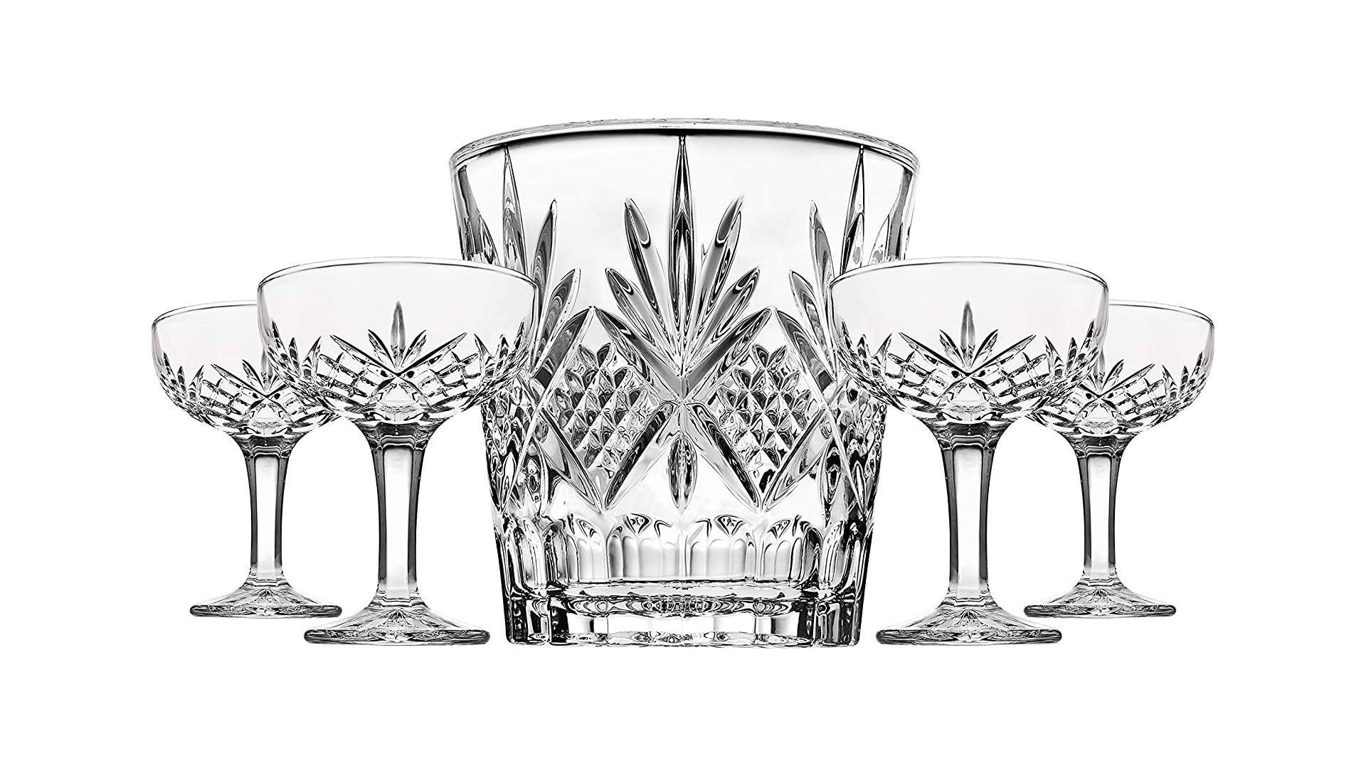Four cut glass U-shaped coupe glasses with large cut glass ice bucket in the center.