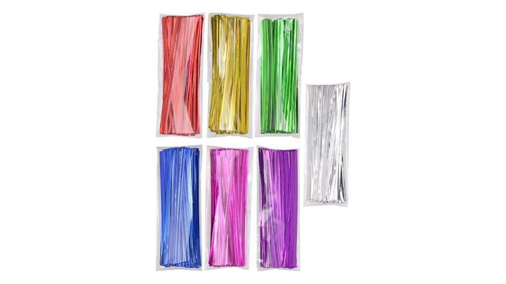 seven bundles of colored twist ties packaged in clear plastic