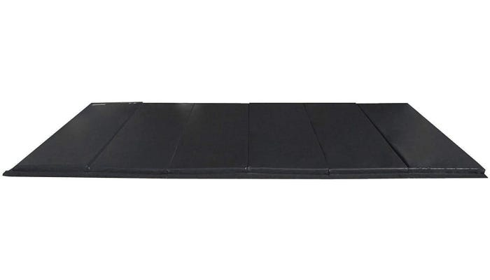 A large black mat shown against a white background.