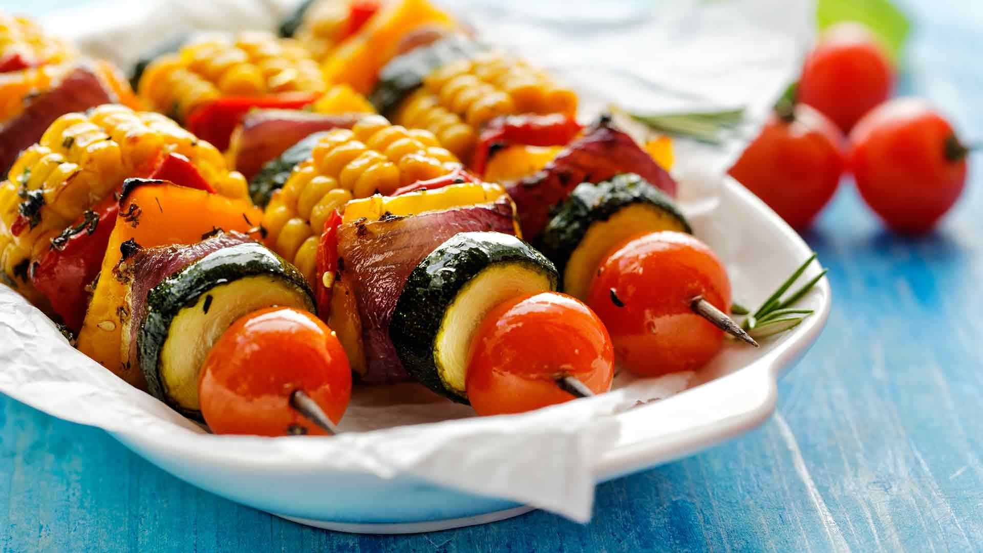 Vegetable skewers with corn.