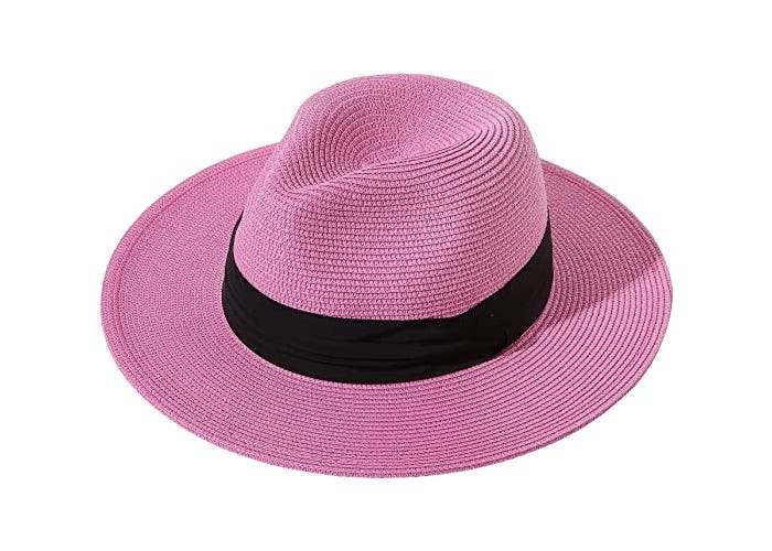 A pink straw fedora with a black ribbon.