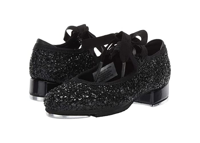 sparkly black pair of little girls' tap shoes with ribbons