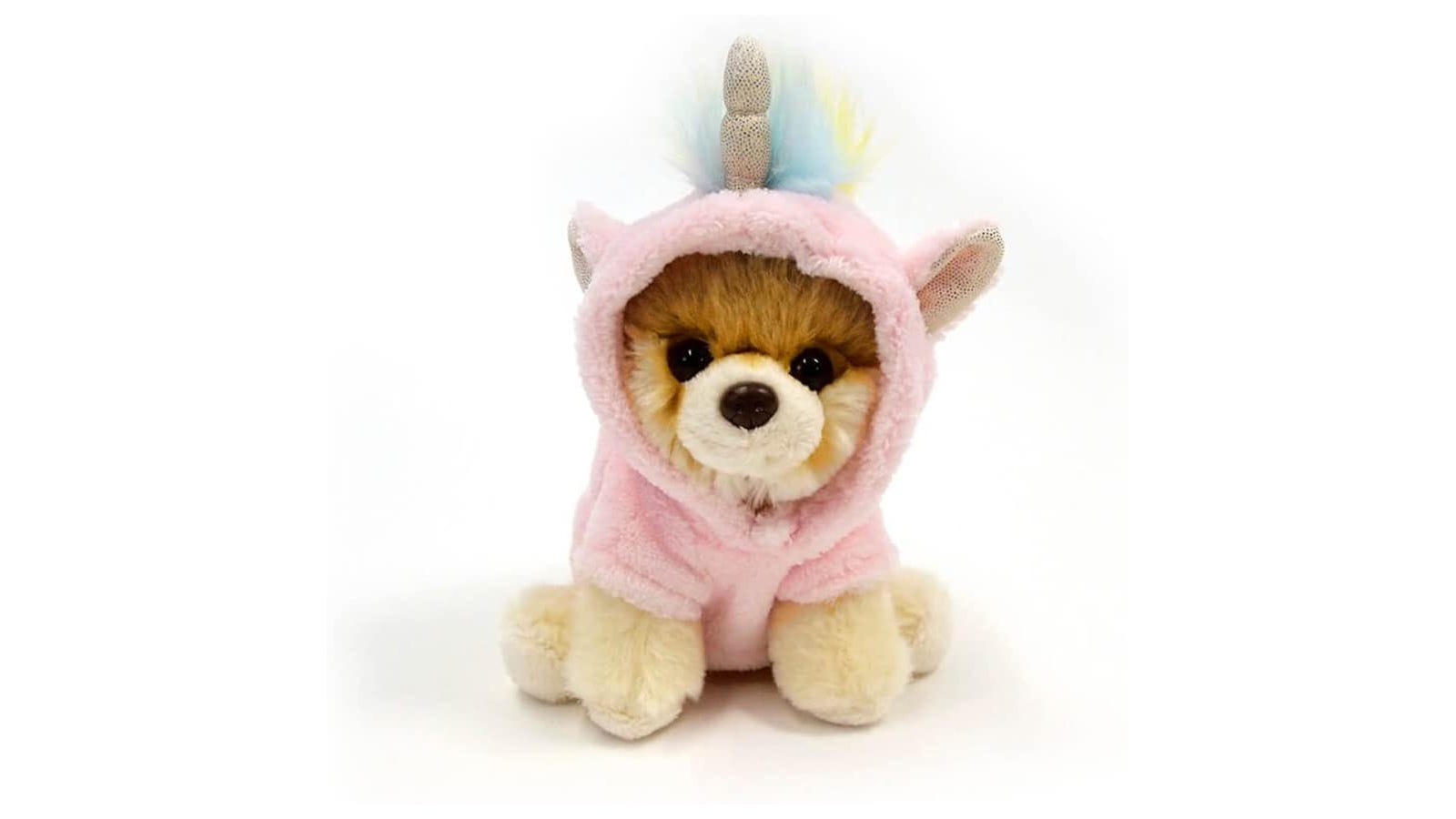 Brown dog stuffed animal wearing a pink hoodie that had a unicorn horn, mane, and ears.