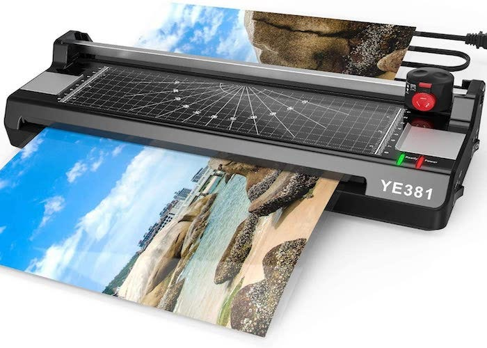 rectangular black laminator in the process of laminating a vacation photo