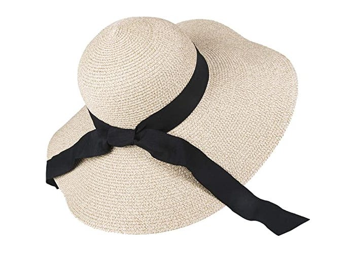 A floppy-brimmed white sunhat with long black ribbon.
