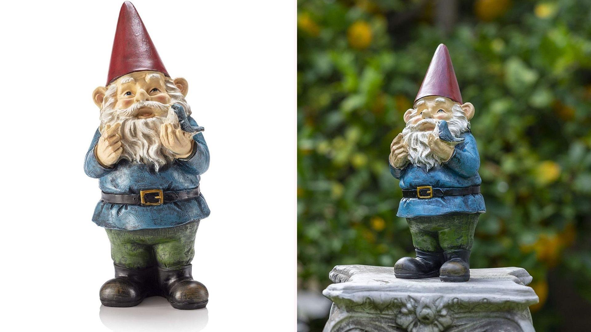 Garden gnome holding a bird statue placed on a stone pillar