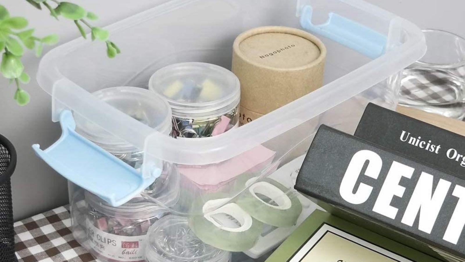 Office supplies packed in a plastic Joyeen bin.