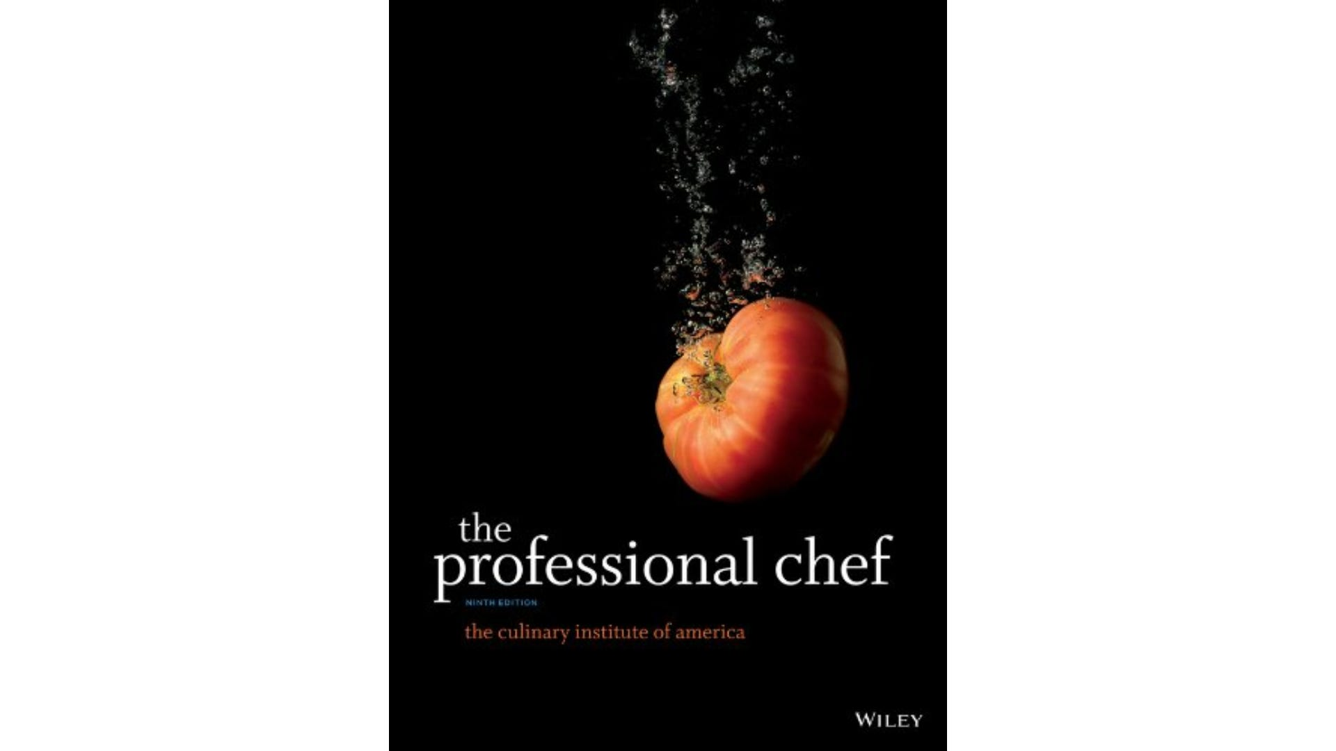 A black book cover that shows a red tomato falling through water.