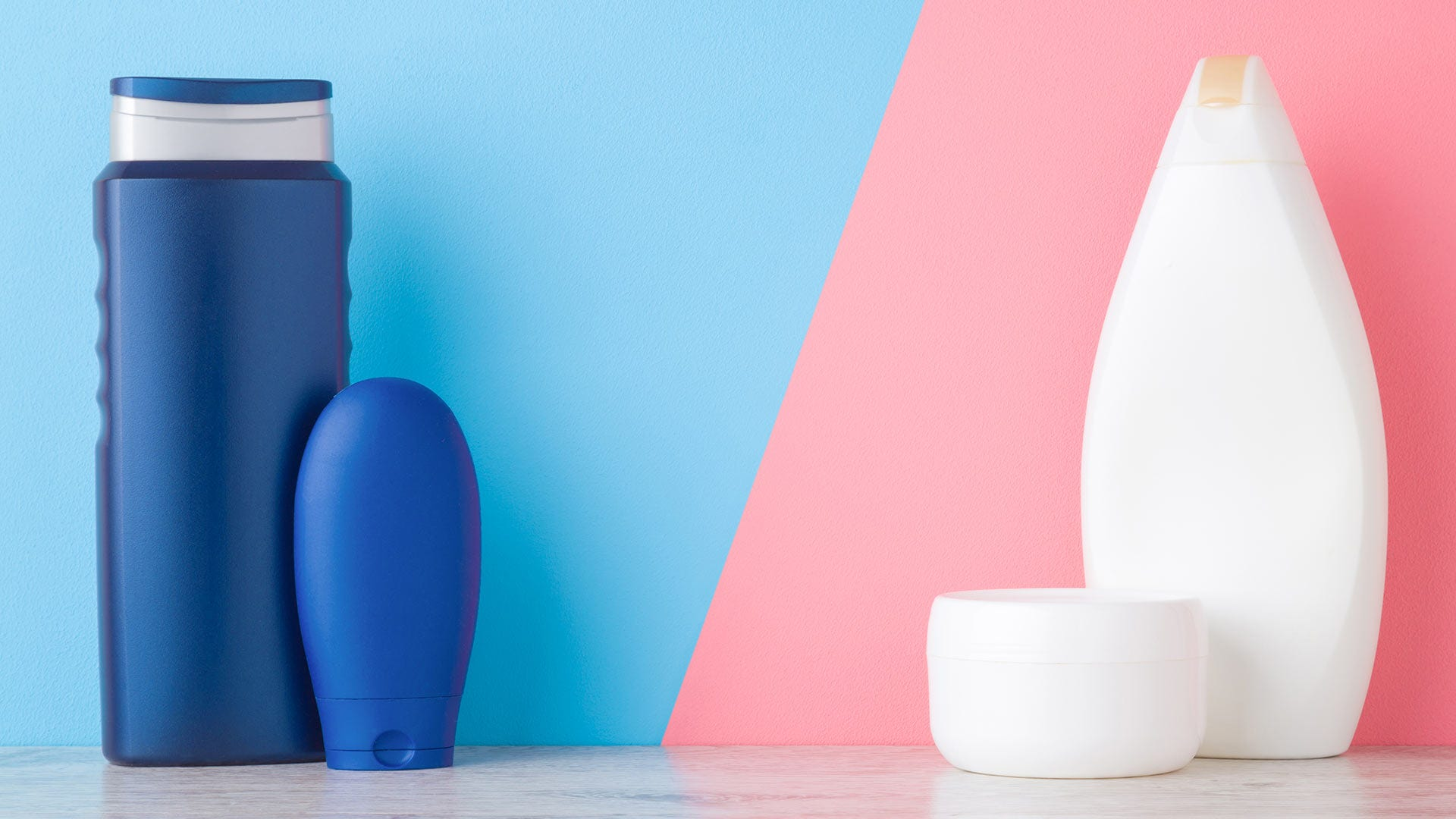 Blue and pink skincare products on a table.