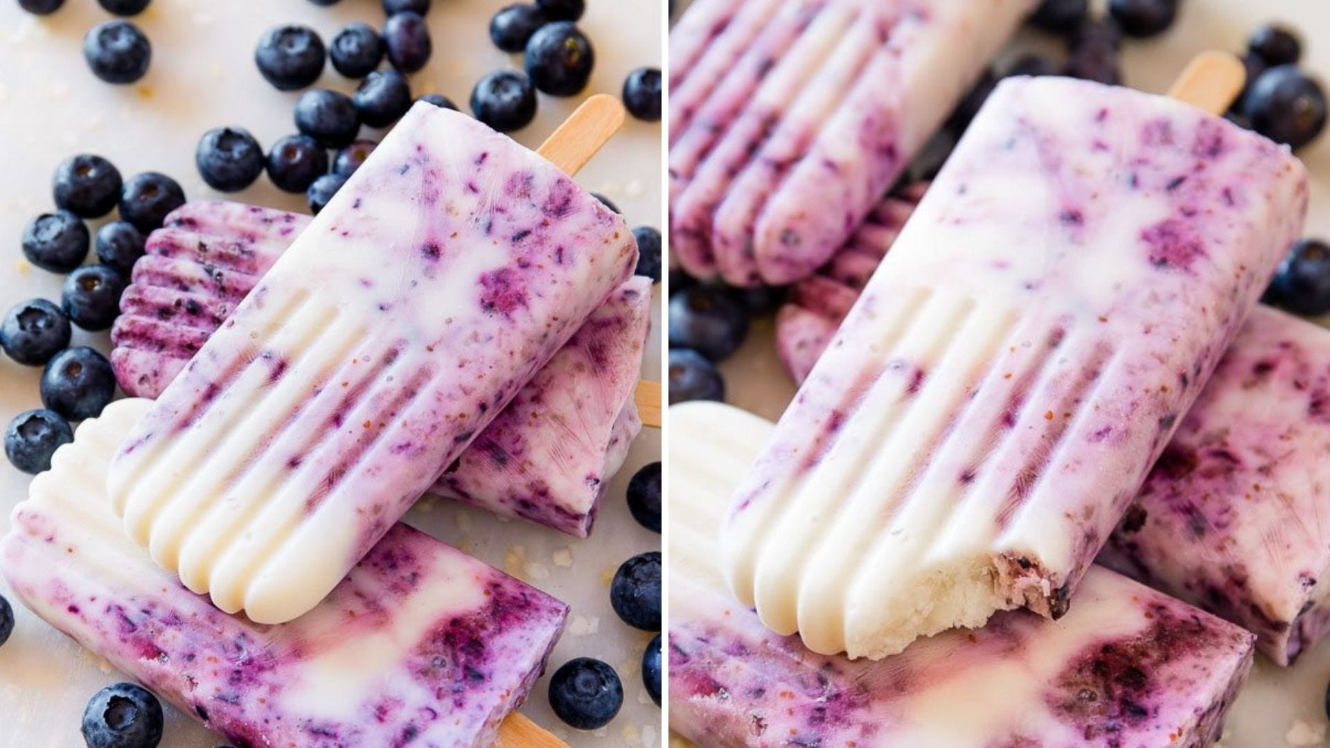 Six Blueberry swirl popsicles lying on top of scattered blueberries.
