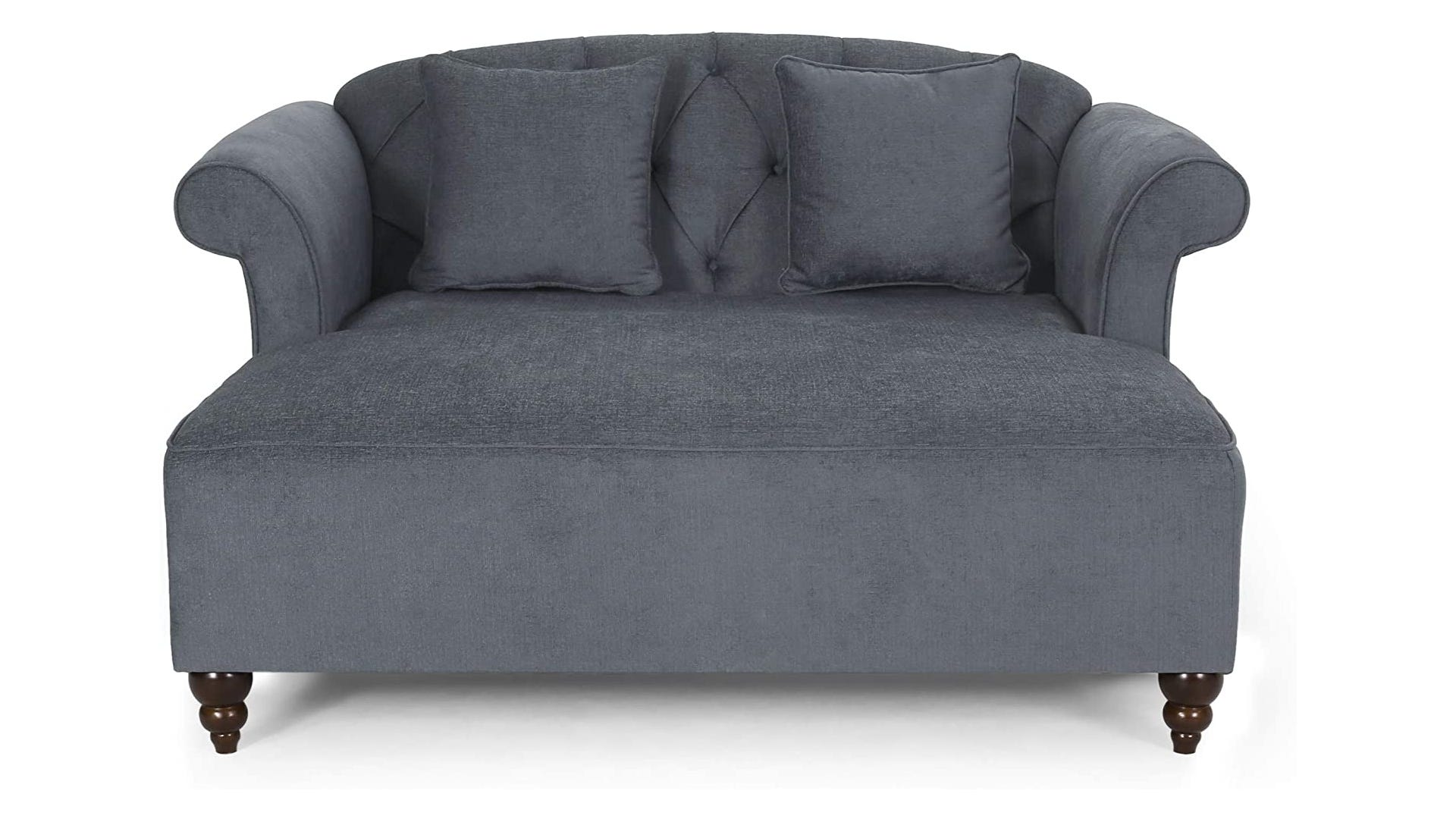 A cushioned gray double lounge chair with two pillows and diamond stitching.