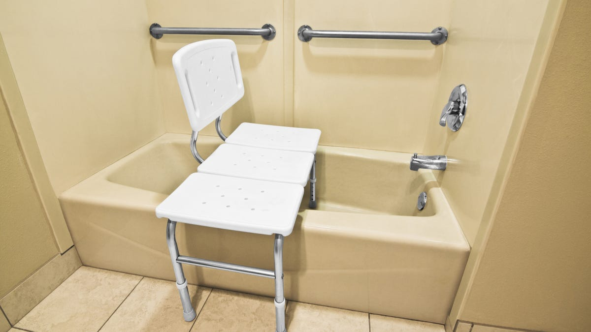 a shower chair in a bathtub for accessibility