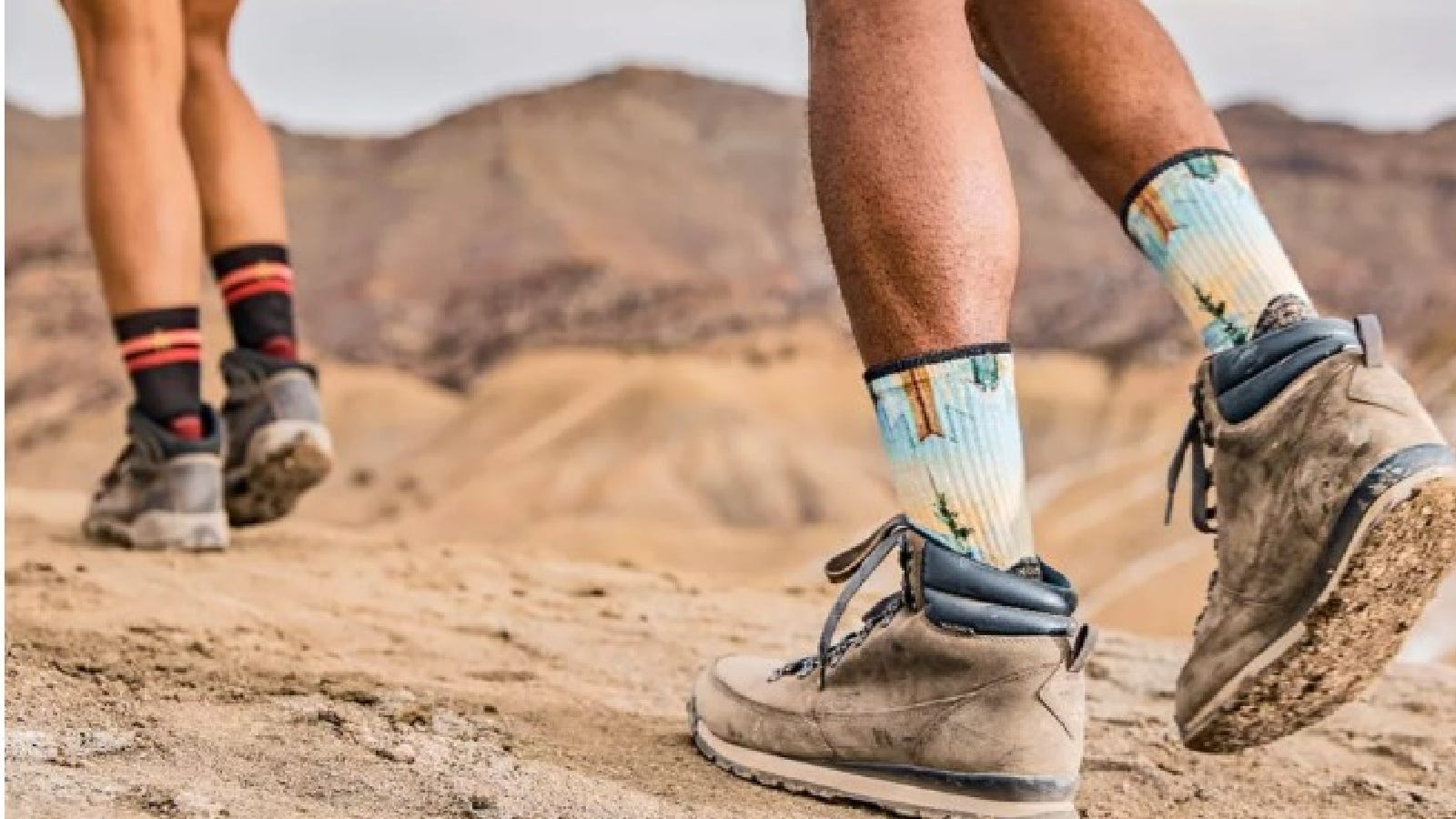 Two people wearing their warm cushioned smartwool hiking socks.