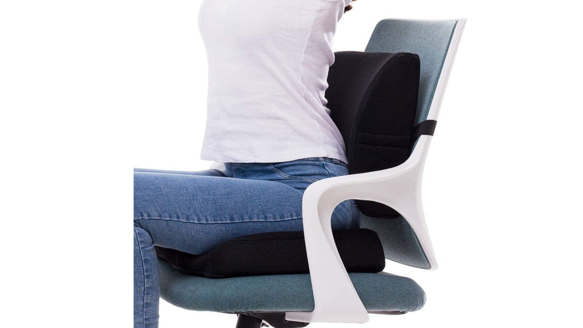 A person sitting in an office chair that has black seat and back cushions.