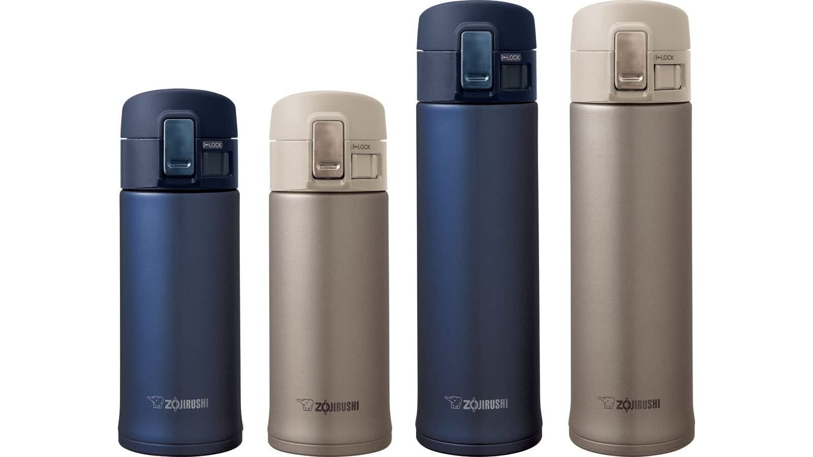 Four different travel mugs with lids in navy blue and beige colors