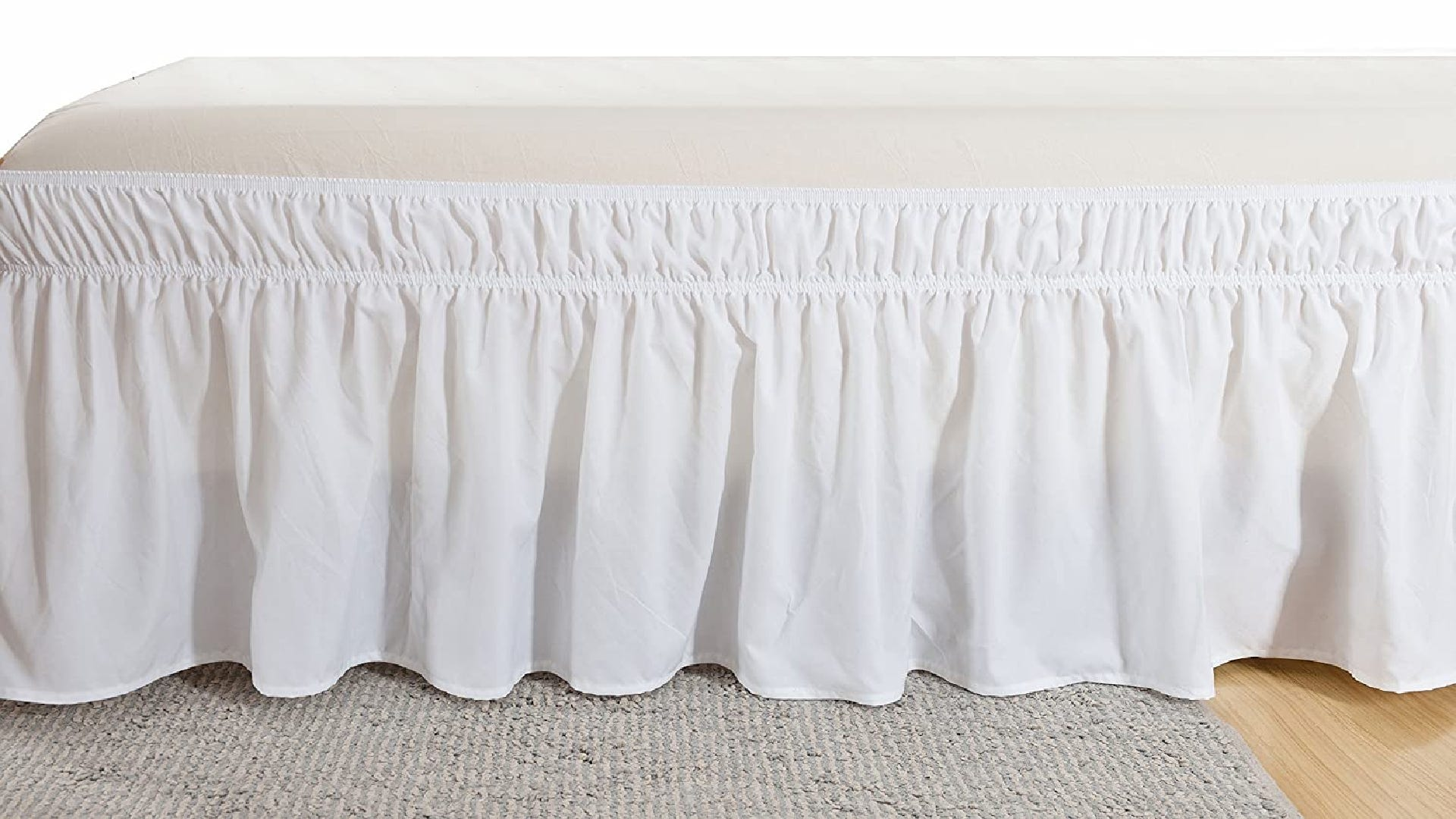 white bed skirt with elastic strap on bed